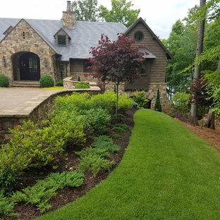 Photo of a mid-sized traditional front yard stone formal garden in Charlotte.