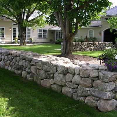 Photo of a large farmhouse partial sun courtyard stone garden path in Boston for summer.