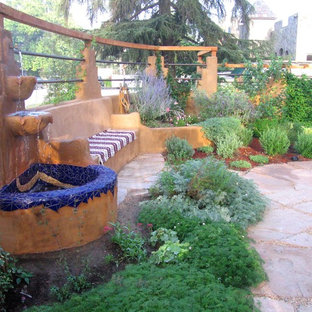 Inspiration for a large mediterranean drought-tolerant and partial sun front yard stone landscaping in Los Angeles for summer.