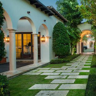 Photo of a huge mediterranean side yard stone garden path in Miami.