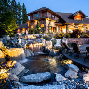 Inspiration for a large traditional backyard gravel water fountain landscape in Seattle.