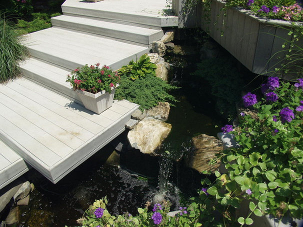 """Contemporary Landscape by Deck and Patio Company """"Outdoor Living Experts"""""""