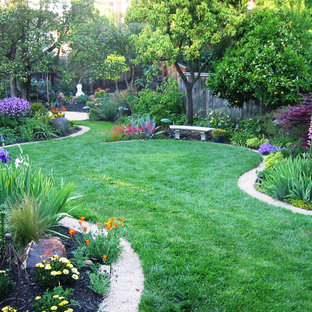 Design ideas for a large traditional partial sun backyard gravel formal garden in San Diego for spring.