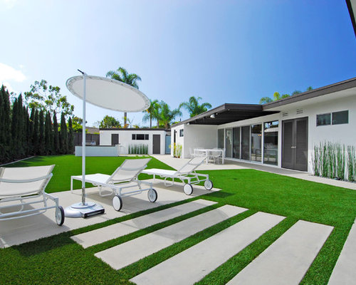 Photo Of A Large Contemporary Full Sun Backyard Concrete Paver Landscaping In Orange County
