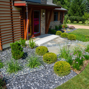 Inspiration for a mid-sized modern drought-tolerant and full sun front yard gravel garden path in Milwaukee for summer.