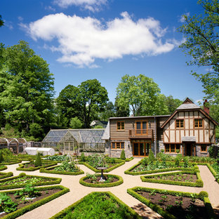 Inspiration for a french country full sun backyard gravel vegetable garden landscape in New York.