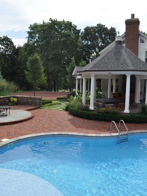 Pool Paver Ideas pool pavers and arborvitae evergreen trees around a pool Design Ideas For A Traditional Backyard Landscape In Chicago With Brick Pavers