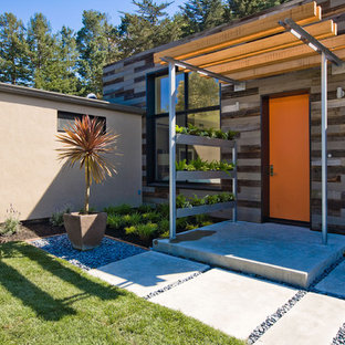 Inspiration for a large contemporary partial sun front yard concrete paver landscaping in San Francisco.