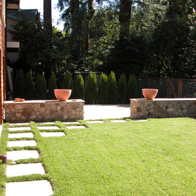 This is an example of a mid-sized traditional full sun backyard stone water fountain landscape in San Francisco.