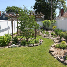 Traditional Landscape by Up Scapes LLC