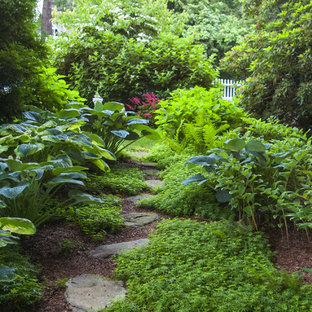 Design ideas for a mid-sized traditional shade side yard stone landscaping in Boston.
