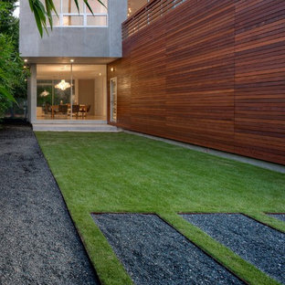 Inspiration for a small modern drought-tolerant and full sun backyard gravel landscaping in Houston for fall.