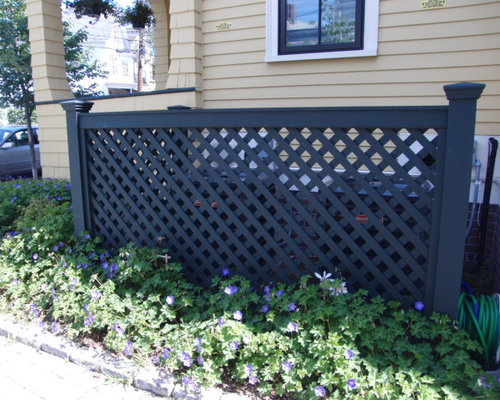 photo of a traditional landscaping in boston - Garden Ideas To Hide Fence