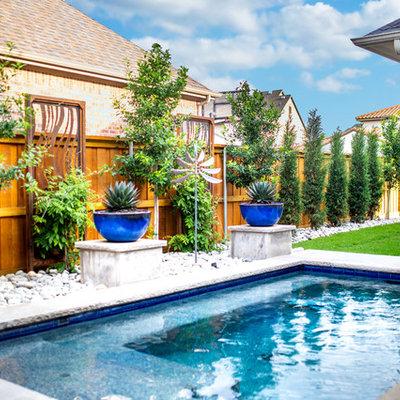 Design ideas for a mid-sized contemporary partial sun backyard landscaping in Dallas.