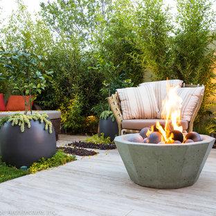 Design ideas for a small modern backyard stone water fountain landscape in Orange County.