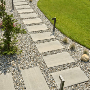 Inspiration for a modern backyard concrete paver landscaping in Philadelphia.