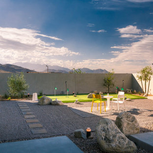 Inspiration for a contemporary full sun gravel and stone fence landscaping in Las Vegas.