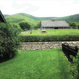 Design ideas for a farmhouse retaining wall landscape in Burlington.