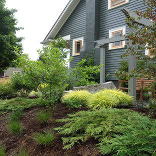 Inspiration for a mid-sized industrial front yard shaded formal garden for summer in Portland with concrete pavers.