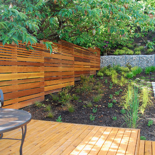 Inspiration for a small modern partial sun and drought-tolerant hillside stone retaining wall landscape in Seattle.