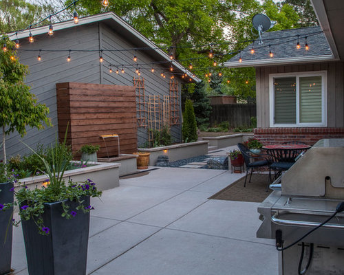 Inspiration For A Small Modern Partial Sun Backyard Stone Landscaping In  Denver.