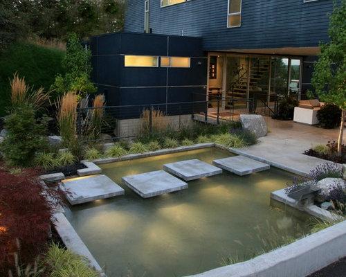Laghetto da giardino moderno foto idee per arredare e - Laghetti da giardino in cemento ...