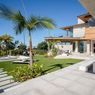 Design ideas for a huge beach style full sun backyard concrete paver garden path in Los Angeles for summer.