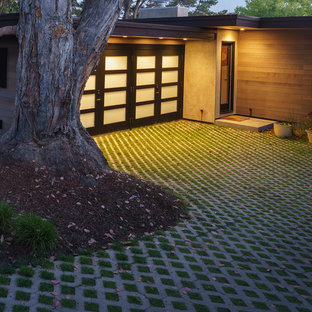 Photo of a large mid-century modern front yard concrete paver driveway in San Francisco.