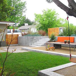 Inspiration pour un jardin design avec un mur de soutènement.