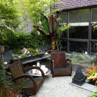 Photo of a tropical courtyard landscaping in Vancouver.