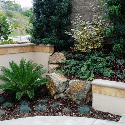 Photo of a mediterranean hillside stone landscaping in San Diego.