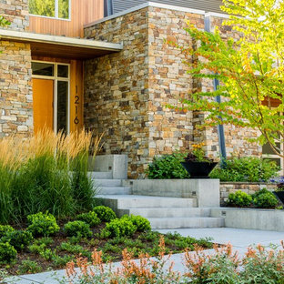 Inspiration for a mid-sized modern front yard full sun formal garden for fall in Seattle with a garden path and natural stone pavers.