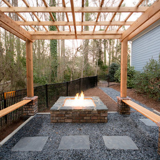 This is an example of a small modern partial sun backyard gravel landscaping in Atlanta with a fire pit for spring.