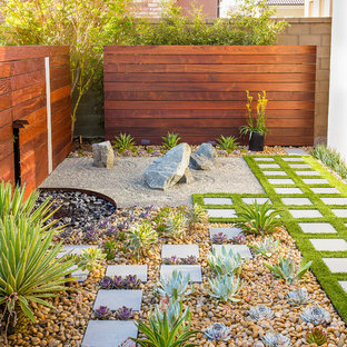 Design ideas for a small contemporary side xeriscape partial sun garden in Orange County with natural stone paving.