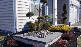 Monroe NJ: Modern Style Landscaping surrounding home and Patio