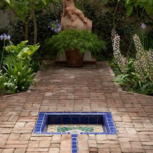 Inspiration for a large mediterranean brick outdoor sport court in Santa Barbara.