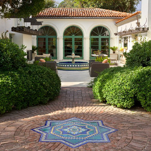 Inspiration for a mediterranean brick formal garden in Santa Barbara.