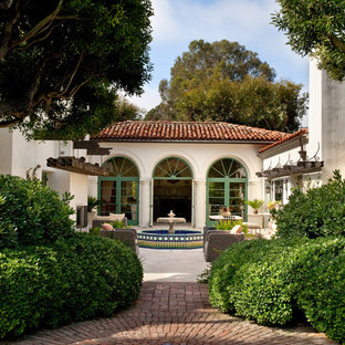 Photo of a mediterranean brick landscaping in Santa Barbara.