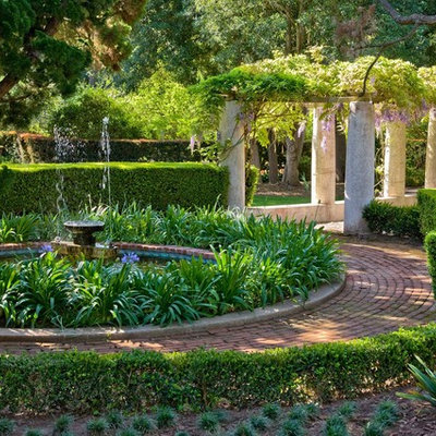 This is an example of a mediterranean partial sun brick landscaping in Santa Barbara for spring.