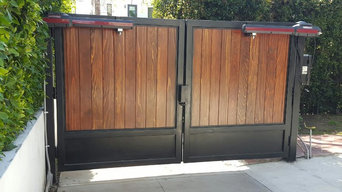 Motorized Iron Framed Gate with Wood Paneling
