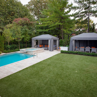 This is an example of a mid-sized contemporary partial sun backyard stone formal garden in Toronto.