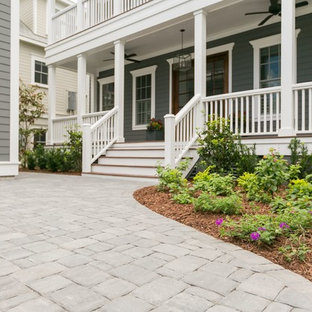Photo of a mid-sized contemporary full sun front yard concrete paver driveway in Charleston for summer.