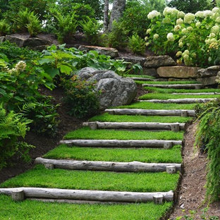 Design ideas for a large traditional partial sun hillside garden path in Other.