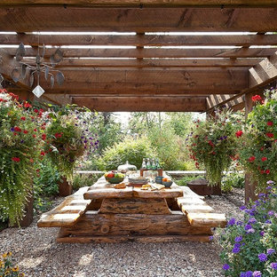 Inspiration for a rustic shade backyard gravel landscaping in Orange County for summer.
