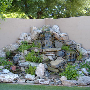 This is an example of a small mediterranean full sun backyard pond in Phoenix.