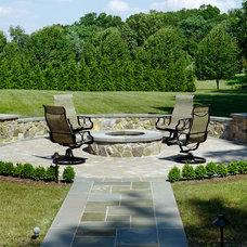 Traditional Landscape by Inviting Spaces