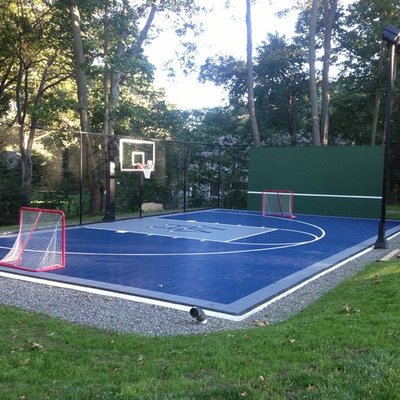 This is an example of a small traditional partial sun backyard concrete paver outdoor sport court in Boston.