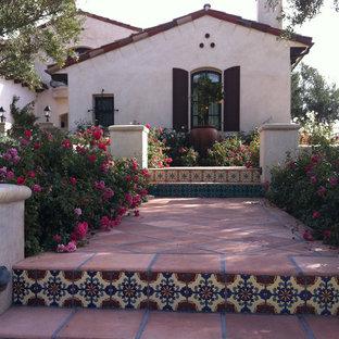 Photo of a mid-sized mediterranean full sun front yard stone garden path in Orange County.