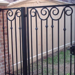 My Hand forged scroll fence -