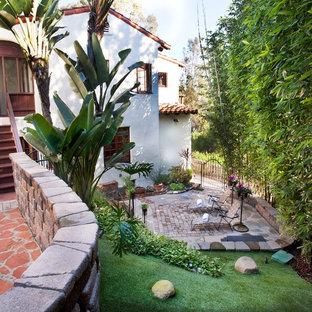 Design ideas for a mediterranean brick landscaping in San Diego.